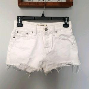 We the Free white distressed shorts